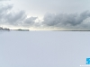Keek uit over een maagdelijk wit strand.