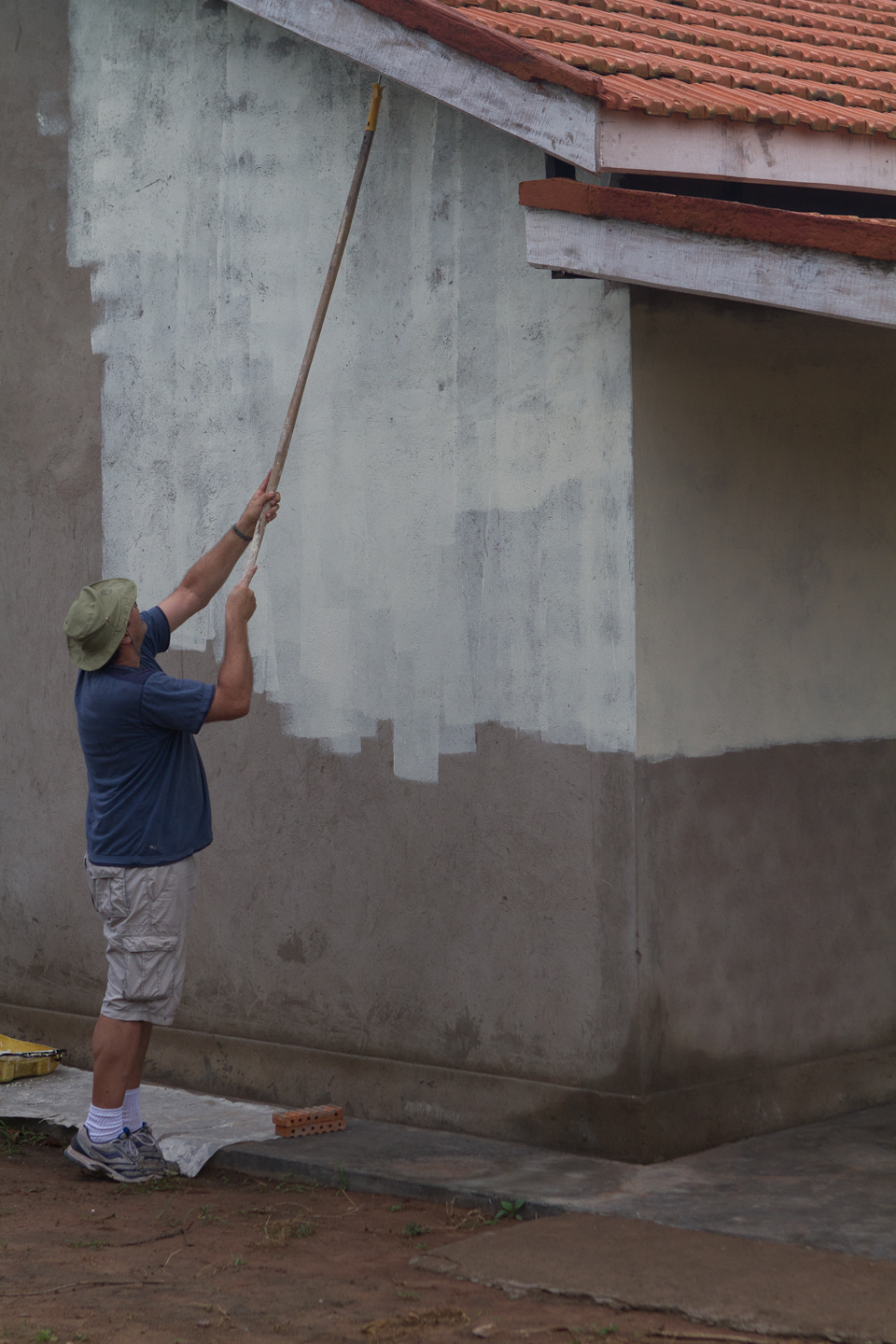 One of the pastors of Crossroads, Jack, painting the school.