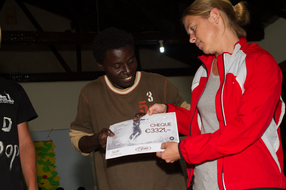 Tim & Wilma Omalla who run Child's Destiny of Hope recieving the cheque for the secondary school.